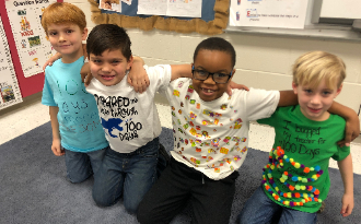 students in 100 day shirts