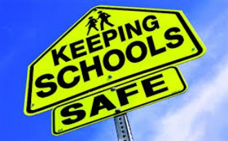 Clipart image of a Keeping Schools Safe sign found at http://clipart-library.com/school-safety.html.