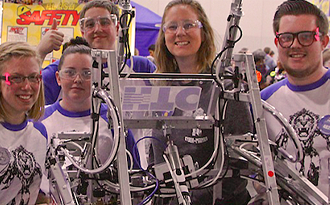 Image of students with a robot for gifted and talented program