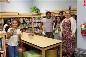 Students and Mrs. Bell with books