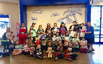The Page Turners Book Club built 32 bears with outfits at Build-a-Bear to donate to the Shriners Hospital for Children