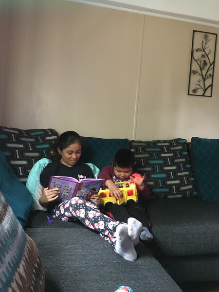 Students reading on couch