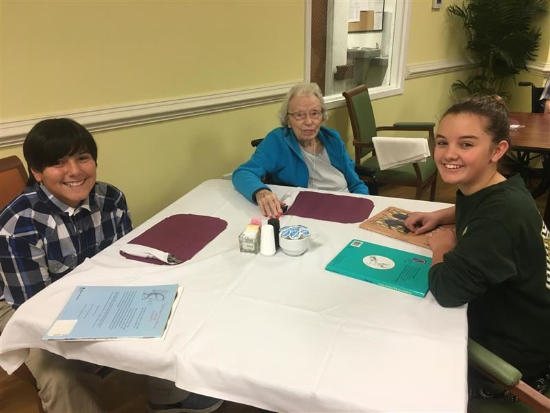 Sixth Grade Students Read to Residents at Anderson Oaks