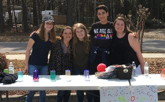 Five HCS Early College Students standing at their Spring Fling Booth